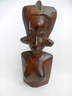 B10854 £22 inc UK post. Offers welcome. A dense very tactile solid wood carved figure of the top half of a female, possibly African in origin. The exact type of wood is not known. The figure has been lightly cleaned only in order to retain what patina there is, but might benefit from further, more expert, cleaning. The carving is structurally sound but the top part of her head piece appears to be missing (see photographs). For further info/photos, please contact us.
