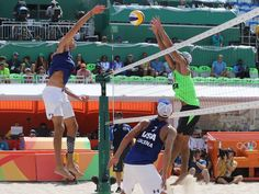 Phil Dalhausser of the United States spikes over Juan