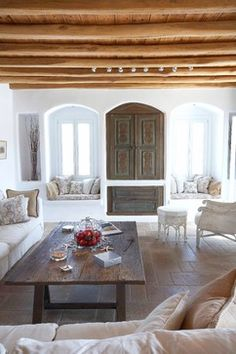 Mykonos villa - varied wood tones, neutrals, tile floor