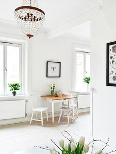 Simple White Decorated Home with small dining table, a stool makes room for a third person #home #decor
