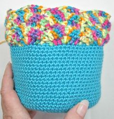 The Hard Crochet Bag is perfect for a makeup bag, just the right size for the little girl in your life, and awesome to organize all your little items. Free Crochet Pattern.
