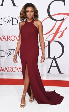 Smart cookie! The Empire star flashes a little leg in this slit oxblood halter Vera Wang gown.