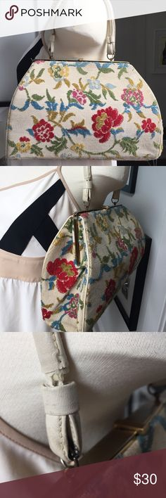 """Vintage Floral Tapestry Carpet Bag Beautiful vintage cream floral carpet bag circa 1950s. Bright red, yellow, green, blue, and pink floral pattern, with gold tone hardware. In good vintage condition. Exterior shows some dirt and minor cracking on strap. Strap pulling out on one side and will require some repair. See photos. Priced as such.   Interior in excellent condition considering age. Very clean.   Measurements: Length - 13"""" Width - 9"""" Depth - 3.5"""" Strap Drop - 6.5""""  C01-X Vintage Bags…"""