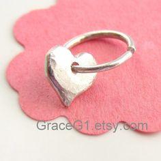 silver heart earrings cartilage earrings cartilage hoop earrings with charms, one hoop. $44.99, via Etsy.