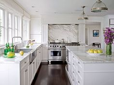 Love this! Dark wood floors, clean white shaker style cabinets, carerra marble countertops, farmhouse sink!