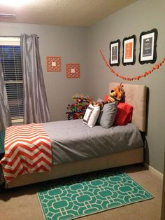 Orange, gray and green boy's room.  Love the simple bedding with pops of color throughout the room