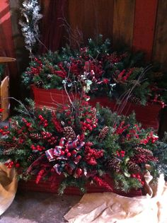 Recycled artificial Christmas trees used to fill window boxes with holiday trim.