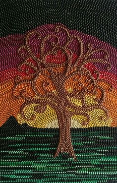 Mardi Gras bead art. 36 × 24 created by Kelly McCracken.