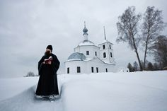 An Orthodox priest on a meditative stroll. Photograph by Gerd Ludwig, Russia, 2009. From National Geographic Image Collection, pages 346-7 (Washington D.C.: National Geographic Society, 2009).