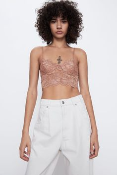 V-neck crop top with adjustable spaghetti straps. Bustiers, Lace Bralette Top, Suspenders For Women, Models, Crop Tops, Beauty Trends, Mannequin, White Shorts, Fashion Beauty
