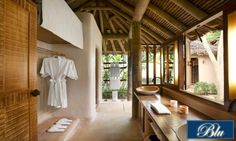 Very soothing bathroom with natural materials straight into nature. This bathroom is located in a villa at The Naka Island, Phuket