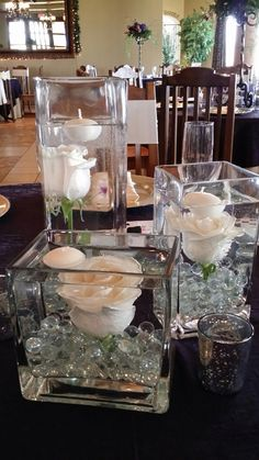 Glass, candles and white roses
