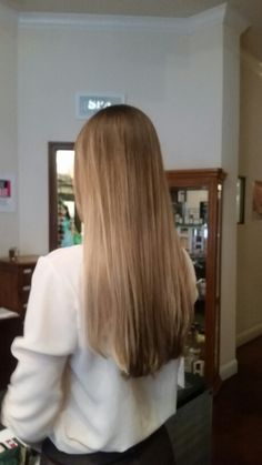 Very subtle ombre, long hair with no layers by Jessi