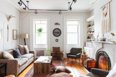 A cute couple transforms a Brooklyn rental with a lot of original architectural features into a Bohemian-Meets-Americana mix of their individual styles.