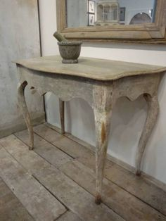 For the little foyer outside the MBR. Do a demilune/find an old table and split it lengthwise. Big rustic mirror in same tone. Consider doing a different flooring pattern in that one spot if it doesn't break it up too much.