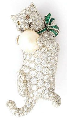 Cat brooch, diamonds with emeralds, a pearl, and sapphire whiskers - owned by Babe Paley.