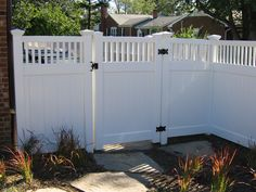love the slats and the cap-toppers. love the black hinges  Google Image Result for http://grahadesain.com/wp-content/uploads/white-paint-vinyl-fence-and-gate-design.jpg