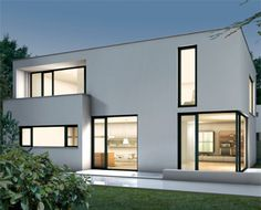 dark framed aluminium windows to a white render contemporary home