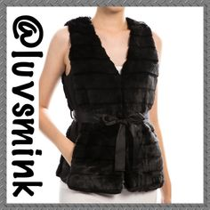 BLACK FAUX FUR SATIN SELF TIE VEST -  MEDIUM Look Chic and Fashion Ready in this adorable faux fur vest with self tie satin sash, and side pockets. Wear with so many different looks; from minis to maxi skirts; leggings to cigarette pants; even over your favorite dress shorts and fishnets!!  Versatile, yet affordable, and Spot On Fashion Trend. 80/20 Acrylic/Poly,  25 inches in Length. NO HOLDS/TRADES. PRICE IS FIRM, unless bundled. COLOR IS BLACK. Size is MEDIUM MayandJuly Jackets & Coats…