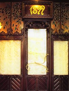 Casa Calvet / Stained Glass / Calvet store entrance door. Today it is an excel lent restaurant where diners are seated on Gaudi's original benches.
