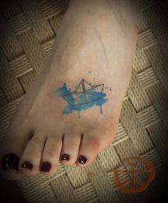 The origami ship tattoo by koray karagozler
