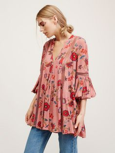 Just the Two of Us Printed Tunic | Crinkly printed babydoll style swing tunic featuring crochet insets and pleat detailing. V-neckline and elastic cuffs with wide statement sleeves.