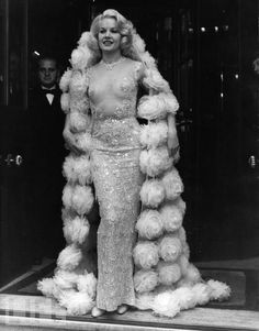 """Carroll Baker in transparent beaded gown with tulle rosette wrap designed by Pierre Balmain to wear to the premiere of her film """"The Carpetbaggers"""". Fashion 60s, Moda Fashion, Fashion History, Vintage Fashion, Fur Fashion, Fashion Black, Latest Fashion, Womens Fashion, Carroll Baker"""