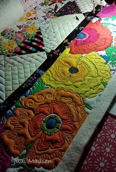 Love how she quilted on the big flowers!!!