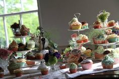 hand made cakes on cake stands and vintage flowers on a hand embroidered table cloth all placed on a Grand Piano