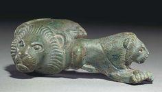 A GREEK BRONZE HANDLE ATTACHMENT SOUTH ITALIAN, ARCHAIC PERIOD, CIRCA 530-500 B.C.