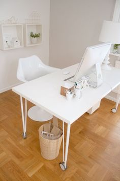 Spiky legs and curvy chair for this white office. From Chez Larsson.