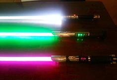 Lightsaber trio. Customs all made from Hamptons Hand-Crafted Lightsabers.   Facebook.com/hamptonshandcraftedlightsabers   Sabers pictured, top to bottom, Imperialist, Transparency and Metallicus
