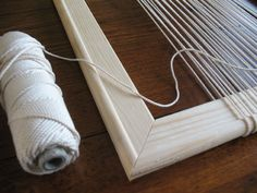 Warping up the tapestry frame ready for weaving