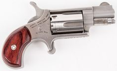 """Lot 32 in the 7.11.17 auction! North American Arms Mini-Revolver in 22LR. Features stainless steel construction, 1"""" barrel, 5 shot capacity, loaded chamber safety notches and wood grip. Condition grades at 90%+ with very little signs of use.  From the internet, """"In the world of production firearms, there aren't many smaller than the offerings from North American Arms. Its Guardian series is about as petite as semi-automatic pistols come. #POGAuctions"""