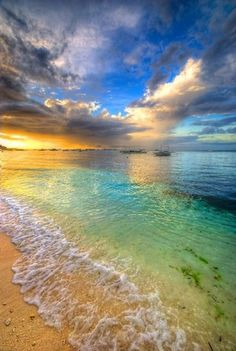 Gorgeous beach and ocean rainbow effect on water