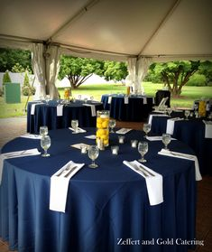 Bright colored lemons and dark blue colors make this outdoor reception space pop! Held at Swan Harbor in Havre De Grace, Maryland. Catered by Zeffert and Gold.
