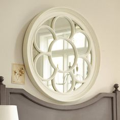 Portofino Mirror.  It is for sure cream, and not off-white. As some of the other reviewers wrote, I have it with my off-white mantel, and it looks great