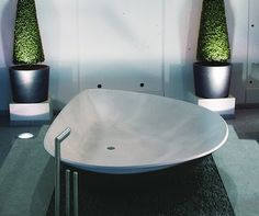 unique bathtubs for two people | This tub by HighTech embraces the sim the simple shapes found in ...