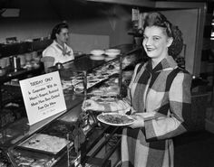 A woman eats at a diner in 1942.