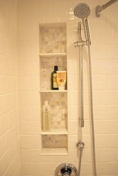 Tile shower shelf, between the studs.  Another pinner said: We did this when we remodeled & it looks so much better than a wire thing hanging on the shower head.
