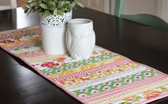 Easy quilt-as-you-go table runner tutorial. Made from fabric scraps. Perfect for spring. Great beginning quilting/sewing pattern.