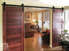 This is what I want to do in my living room before I sell my house someday. Only make the doors myself from some (hopefully!) beat-up wood, and build to look like a real barn door. I think I want a Windows door. Sliding Door Room Dividers, Wooden Room Dividers, Hanging Room Dividers, Room Divider Doors, Closet Doors, Cabinet Closet, Divider Cabinet, Garage Doors, Double Sliding Barn Doors