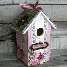 You might find a chipboard birdhouse from Kaiser Craft.  Use vintage scrapbook paper and decorate with paper flowers, lace, buttons, etc.