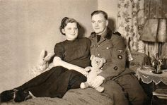 Glorious Moments in the 1,000 Year Reich: A Waffen-SS man, his wife, and two stuffed animals, via Jedem das Seine