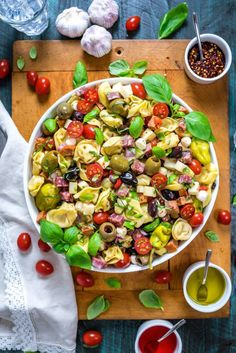 Antipasto Tortellini Pasta Salad in a large white bowl that rests on top of a wooden cutting board. Pasta Salad With Tortellini, Cheese Tortellini, Pasta Carbonara, Pasta Salad Ingredients, Pasta Salad Recipes, Summer Side Dishes, The Best, Food And Drink, Cooking Recipes