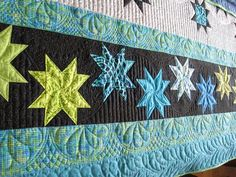 Beautiful quilting by Donna- love the larger looped quilting on right with small same on left.