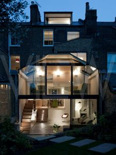 This is more of a bespoke two storey conservatory than a rear extension , if you love glass then you'll this.