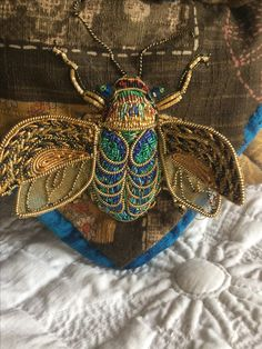 bead and embroidery inspiration Goldwork Beetle Book(l evans?) MagpieGoldwork Buying A Watch As A Gi Gold Embroidery, Embroidery Stitches, Embroidery Designs, Crazy Quilting, Beaded Brooch, Beaded Jewelry, Jewellery, Insect Art, Textiles
