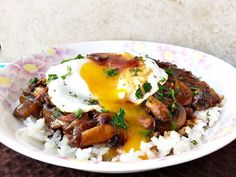 One of Hawaii's most popular dishes, loco moco served with a savory gravy with mushrooms and caramelized onions