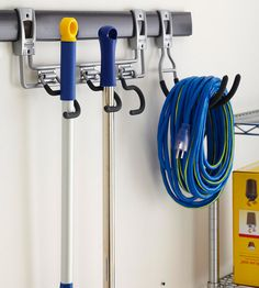 Wall-mounted rails are a space-savvy way to store larger items out of harm's way. This organizer features three S-hooks to secure long-handled tools, while a utility hook keeps items such as hoses, ropes, and extension cords tightly coiled.
